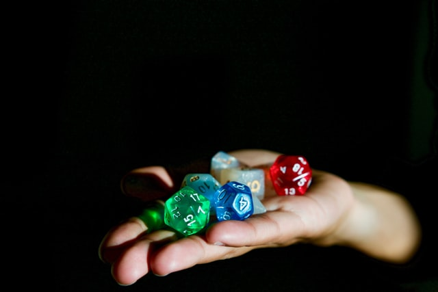 A hand outstreached with a set of rpg dice in them